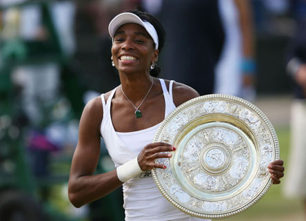 The 5-time Wimbledon champ holding one of her trophies