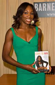 At a book signing for Come to Win. Venus also has her own video game, Venus: The Case of the Grand Slam Queen