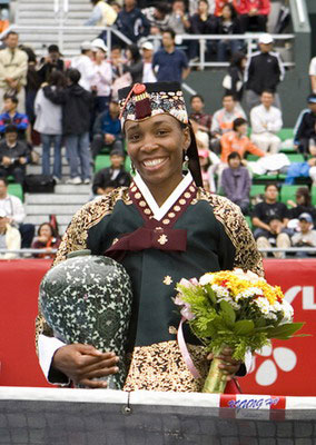 At an awards ceremony in Hanbok, Korea, where she was presented with a vase of Korean green porcelain