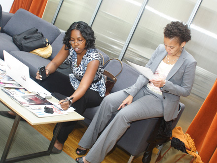Renita Burns, BLACK ENTERPRISE Online Producer (left), asks the BLACK ENTERPRISE Facebook and Twitter communities to submit their questions about bringing an invention to market, while BLACK ENTERPRISE Small Business Editor Tennille Robinson (right) goes over some notes.
