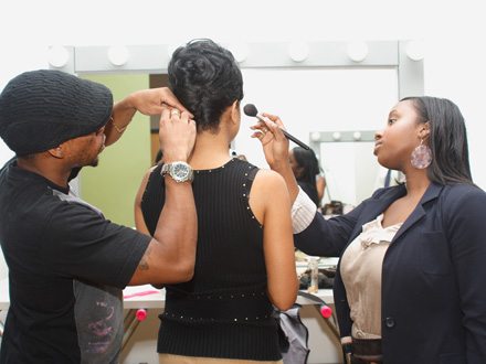 Hair stylist Clark Vincent (left) and makeup artist Natasha Denis (right) prep one of our featured inventors, Elaine Cato. Cato created the Breakthrough Backless Bra, which she licensed out to undergarment manufacturer Maidenform. Her bra is sold in Macy's and other large retailers nationwide.