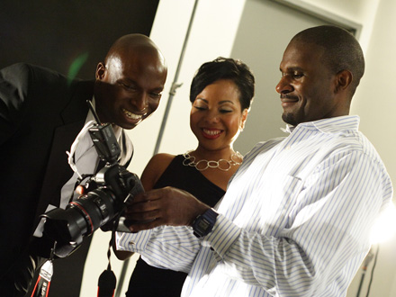 BLACK ENTERPRISE Associate Photography Director Lonnie Major (right) shows Woolery and Cato outtakes from the photo shoot.