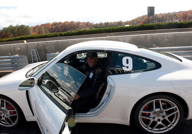 Terry L. Jones, Managing Partner, SYNCOM Venture Partners tries a Porsche on for size.