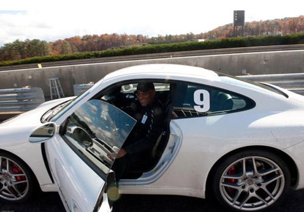 Terry L. Jones, Managing Partner, SYNCOM Venture Partners tries a Porsche on for size.