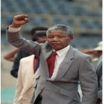 "Prison Break  	On February 11, 1990, Mandela was freed from prison after serving 27 years behind bars in Victor-Verster Prison in Paarl, near Cape Town. He was sentenced to life imprisonment in 1964 for treason, so the release came as a surprise. Few can forget the image of him walking hand-in-hand with his then-wife, Winnie, into the surrounding pack of overjoyed supporters.  He later addressed a crowd of 50,000 people on the balcony of Cape Town's City Hall. ""Our struggle has reached a decisive moment. Our march to freedom is irreversible,"" Mandela said."