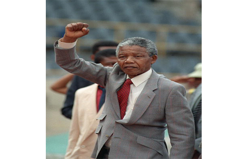 """Prison Break  On February 11, 1990, Mandela was freed from prison after serving 27 years behind bars in Victor-Verster Prison in Paarl, near Cape Town. He was sentenced to life imprisonment in 1964 for treason, so the release came as a surprise. Few can forget the image of him walking hand-in-hand with his then-wife, Winnie, into the surrounding pack of overjoyed supporters.  He later addressed a crowd of 50,000 people on the balcony of Cape Town's City Hall. """"Our struggle has reached a decisive moment. Our march to freedom is irreversible,"""" Mandela said."""