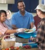 Black couple giving back in a soup kitchen