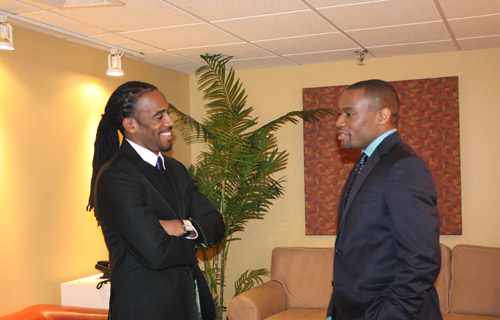 Jeff Johnson and Marc Lamont Hill in heavy discussion back stage