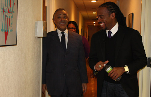 Rev. Al Sharpton and Jeff Johnson share a moment before hitting the Our World stage