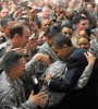 US President Barack Obama (R) greets tro
