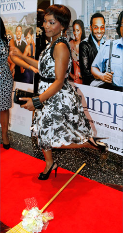 Actress Angela Bassett literally jumps the broom on the red carpet for the Dallas screening