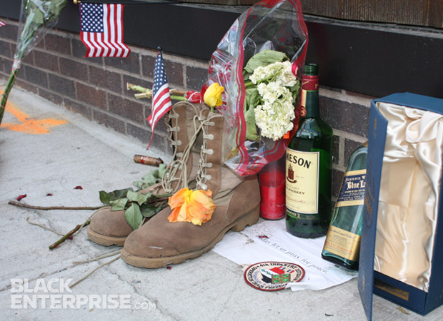 Personal memorial with soldier's boots, roses, flags and liquor at 9/11 wreath ceremony