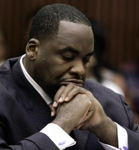 Former Detroit Mayor Kwame Kilpatrick with head down