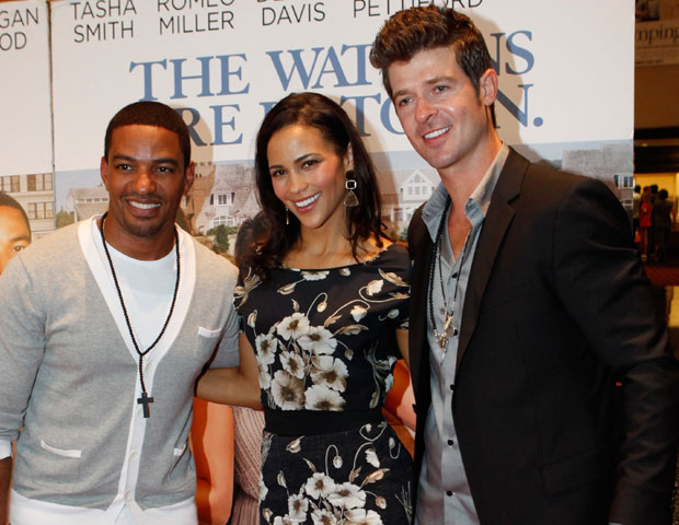 Actress Paula Patton poses with her on-screen husband, Laz Alonso, and real-life husband, singer Robin Thicke