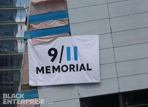 9/11 memorial banner at world trade center site during wreath ceremony