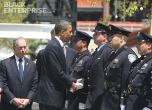 President Obama greeting officers at the 9/11 memorial wreath ceremony