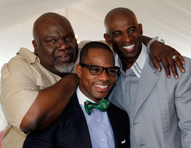 Bishop T.D. Jakes embraces brotherhood with gospel singer Kirk Franklin and former NFL great Deion Sanders during the Easter brunch