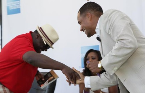 Inside joke: Hill Harper shares a laugh, and a book, with Cedric the Entertainer.