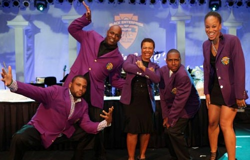 We are the champions: Purple jacket winners pose with actor/comedian Anthony Anderson.