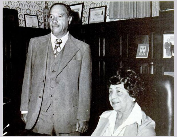 BELL BROADCASTING CO.: Wendell Cox (standing), co-founder of Bell Broadcasting Co. Cox started the company with his wife Iris' (seated) father, Haley Bell. Their flagship station was WCHB.