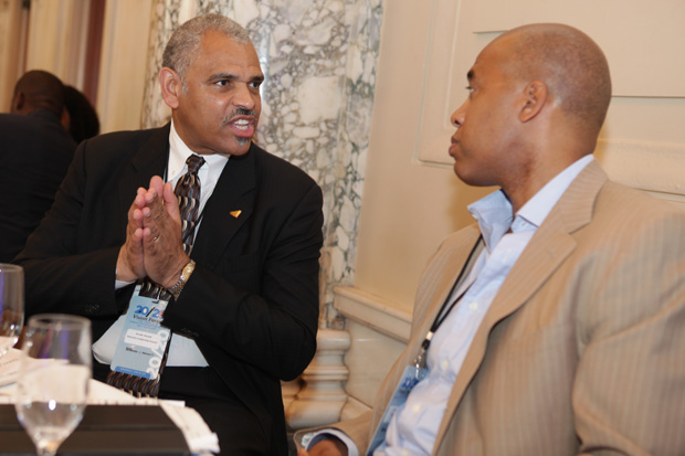 Arnold Donald, president & CEO of the Executive Leadership Council (l), discussed matters with panelist Ron Mitchell