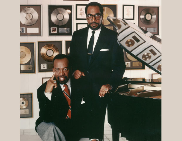 "PHILADELPHIA INTERNATIONAL RECORDS: Kenneth Gamble (standing), co-founder and chairman of Philadelphia International Records (1971) with Leon Huff (seated). Gamble and Huff, songwriting and producing partners for more than 30 years, created the musical style known as the ""Philly sound."""