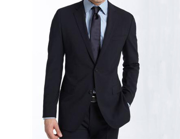 BLUE SUIT:  A dark blue two-button suit is just as versatile as that white shirt and great when paired with each other. Wear this BOSS Black 'Jam/Sharp' Trim Fit Navy stretch wool suit ($795) for that important meeting and later throw on just the jacket over a pair of dark denim jeans and see what the city has to offer once the sun goes down. Editor's note: When packing your suits put them inside a drycleaners plastic bag with the hanger, then tie the bottom, keeping a bit of air left inside; this will create an air pocket that will make wrinkles less likely.