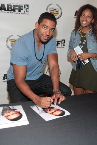 Actor Laz Alonzo signs a head shot for an adoring fan in the Cadillac Lounge. (Photo by Terrence Jennings)