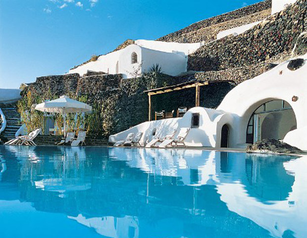 SANTORINI, GREECE  Surrounded by breathtaking vistas and high cliffs, the volcanic island of Santorini feels as if you have floated into heaven.  	Stay: Perivolas Hotel or Aqua Suites 	Eat: Il Cantuccio, Ambrosia or Taverna Kritikos 	Shop: Go to Fira for the best in jewelry and ceramics. 	See and Do: Tour the islands and waterways of the caldera with a private catamaran, and don't miss the black sand beach. In September, check out the International Classical Music Festival.
