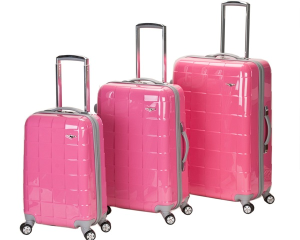 THINK PINK There's somethigngspecial about charm, even when it comes to your luggage. Each piece is 100% polycarbonate. Translation: spills will roll right off and a few wipes with a soft damp cloth and it will look like new.  If you're not quite a   Kimora Lee Simmons meets Mariah Carey type packer, you can split the set up for the family, or just use one piece at a time. You'll feel pretty and support breast cancer all in one trip. Rockland Luggage 3 Piece Celebrity Hardside Spinner Set, $199, ebags.com