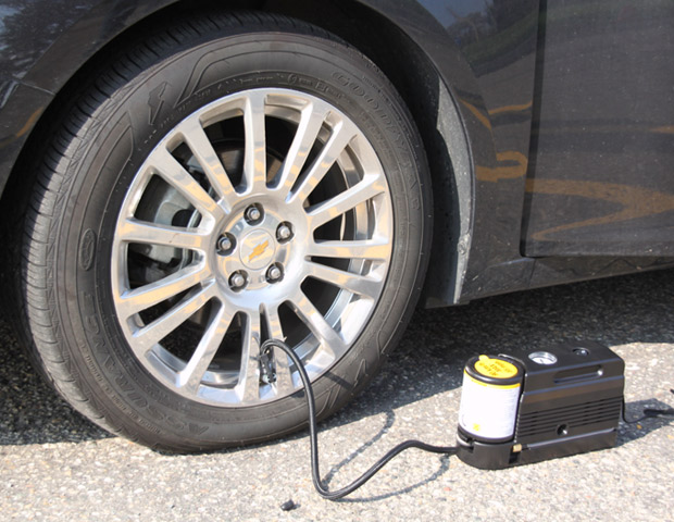 NO MORE SPARE TIRES (GM)  Is that spare tire taking up room in your trunk? While many of the experts were advising drivers to clean out the trunk to increase gas mileage, not one knew General Motors was making plans to eliminate spare tires entirely. In its new Chevy Cruze, GM equips the compact with an on-board tire inflator kit. General Motors claims eliminating the spare sheds approximately 26 pounds in total car weight. If your tire is irreparable (even beyond the kit's assistance), drivers can press GM's trademark OnStar button on the rearview mirror to request emergency roadside assistance.