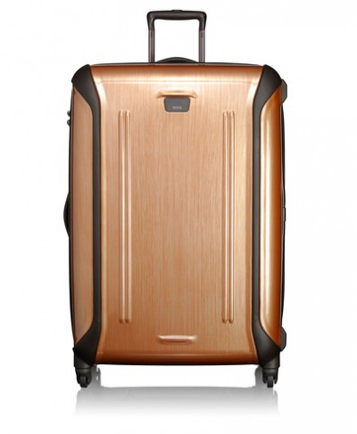 THE GOLDEN CHILD Raise the bar from the commonly seen platinum luggage to the new sleek golden, shiny copper.  Both lightweight and durable, the roomy suitcase is perfect for a lengthy stay or couples looking to save on the bag check fees and   pack as one. Designed with four 360 degrees swivel wheels, you are granted access to go around the world in a posh whirl. And not to worry, the hard graphic exterior surface helps to reduce the appearance of scratches and marks   from those who have less appreciation for the shinier things in life. TUMI Copper Extended Trip Packing Case, $595, tumi.com