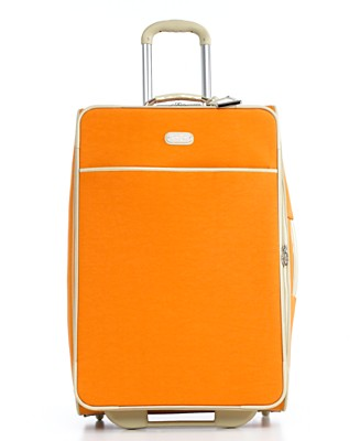 "SUNNY SKIES Long gone are the possibilities of overlooking your luggage or mix-ups between similar looking baggage. After a long tiresome red eye, your mood and energy will instantly be uplifted after easily spotting your bright citrus hued honey   coming down the conveyor belt.  Packed with a portable travel kit, detachable wet pouch, and more, this eye candy offers the stability of any traditional suitcase, with a lot more punch and style indeed.  Jessica Simpson Suitcase, 24"" Spoonful of Sugar Rolling Upright, $159.99, macys.com"