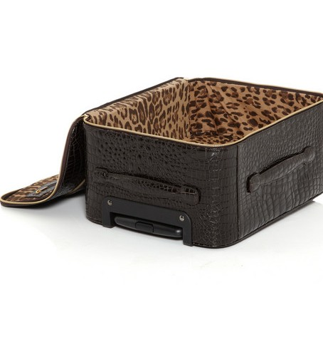 THE FAB LANE Ideal for the luxe jetsetter, this espresso brown croc embossed patent suitcase is a stylish solution to packing for any last minute meeting away.  It truly embodies the chic combination of style and function, including easy roll wheels, an extendable top handle, and the posh designer stamped gold hardware. Suitable to fit in most overhead bins, travelling in style is now given new meaning. Jimmy Choo Terence crocodile-effect leather suitcase, $3,595, net-a-porter.com