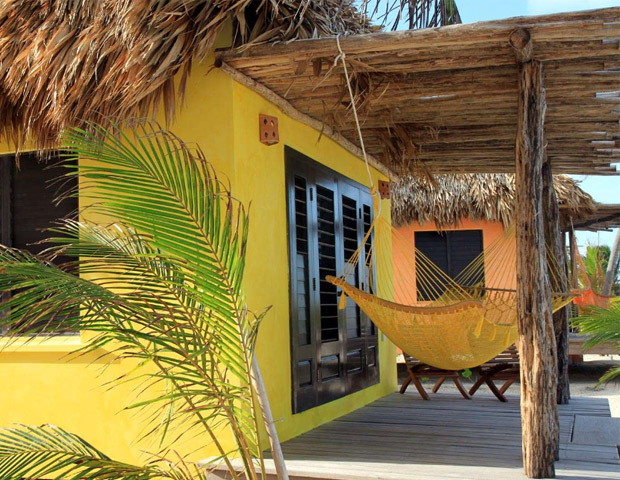 MATACHICA RESORT  	Ambergris Caye, Belize, Central America 	The Matachica Resort and Spa is the best kept secret in Belize. Just off the Caribbean Coast, the tropical appeal sets the tone for its relaxing and cozy scene.  From ocean front bungalows to a seaside mansion, the accommodations are spacious and locally designed. Sample the resort's award-winning restaurant, or explore the azure waters by kayaking or snorkeling. 	Reason to stay: Relaxing getaway 	Rates: From $195