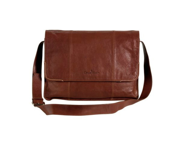 """HIS BAG: Bulging pockets and hands laden down with everything from your PDA to your lunch simple just won't work when it comes to presenting a polished professional look to the world. A great alternative to a briefcase is a messenger bag (not to be confused with the """"man purse""""). Keep all of your work and tech essentials in one central location with something like this Cole Haan carrier in a neutral and durable leather."""