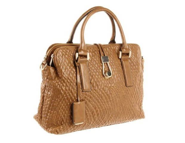 HER BAG: The oversized, classic bag is essential for the working woman. This fall, the satchel silhouette works wonders when it comes to style and functionality. This one, from Ivanka Trump's line ($175), features quilted leather and a detachable strap. The neutral color allows for everyday wear and can be dressed up or down.