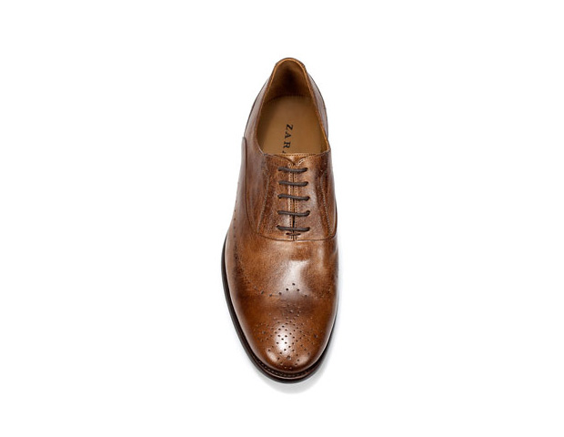 HIS SHOE: Step up your shoe game with the classic oxford. Today's versions are sleek and grown up, not too stuffy and aren't the shoe of grandpas past. Go for a leather neutral like brown, black or grey such as this Vintage Oxford ($99.90; Zara).