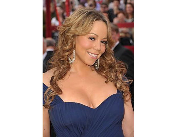 Mariah Carey, 41     Wife of young television executive (and BE Nexter) Nick Cannon and mother of twins Monroe and Moroccan, Carey is an R&B and pop icon. The multiracial starlet (receives her African-American and Venezuelan roots from her father and Irish ethnicity from her mother) has released 13 albums to date, winning numerous awards, including several American Music Awards, a slew of Billboard Music Awards, and 5 Grammy Awards. The multi-platinum artist has even flexed her entrepreneurial muscles releasing her line of fragrances and a lifestyle line for HSN.