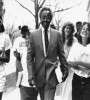 Derrick Bell walking with a group of Harvard law students (Image: Getty)