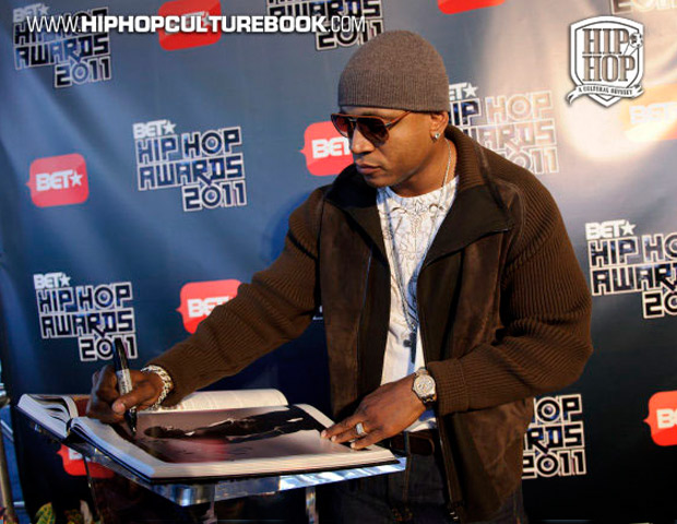 """I Am Hip-Hop Icon"" honoree LL Cool J autographs his Game Changer essay."