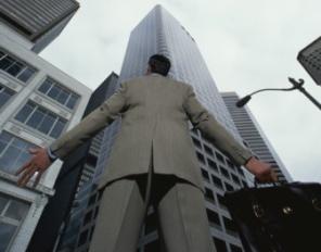 businesssman-struggle-062011-296x232.jpg