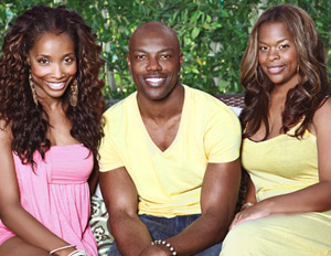 "Williams and Jackson with their client, NFL star Terrell ""T.O."" Owens"