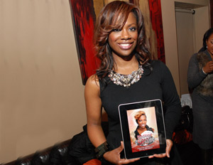 Singer/songwriter Kandi Burress shows off her Kandi Koated Spades