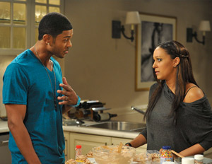 Actors Pooch Hall & Tia Mowry-Hardrict in character on set of The Game