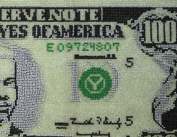 A closeup of Woolery's Black $100 bill portrait