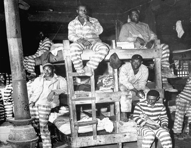 Archive photo of young Black convicts in prison barracks