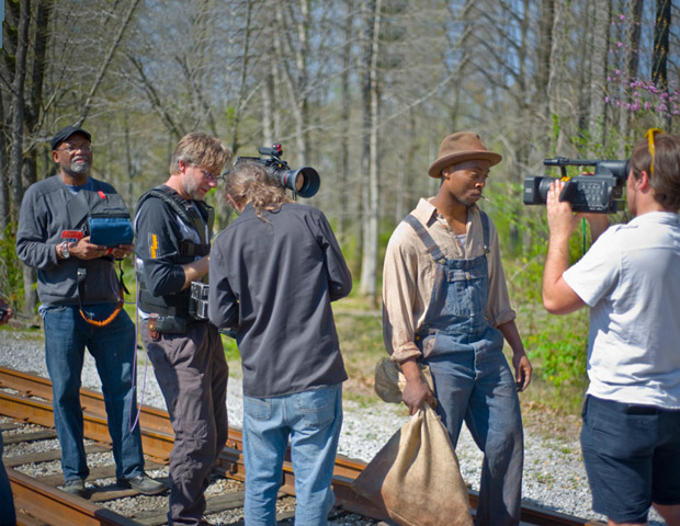 Pollard (far left) directs a scene from Slavery By Another Name