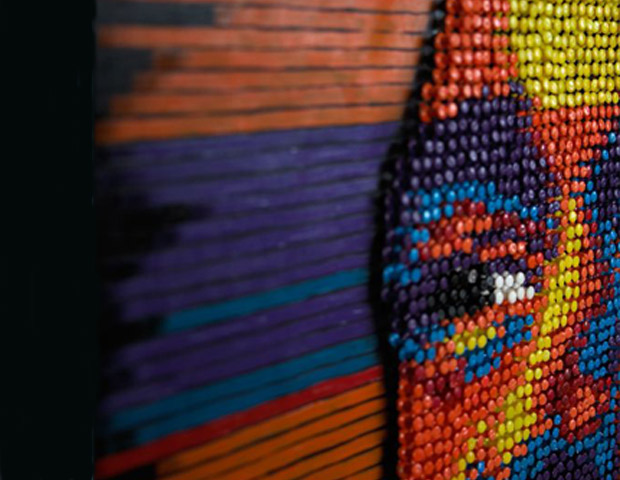 A closeup of the Kanye West mural, painstakingly constructed from colored thumbtacks