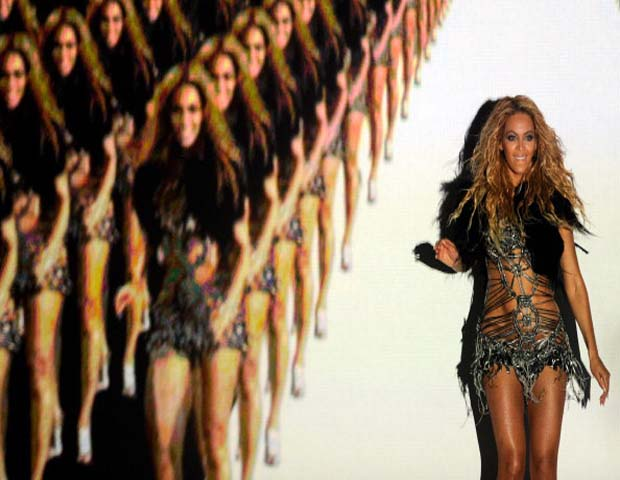 Beyoncé Dances with Video Projected Clones       The Grammy Award-winning artist (and proud new mom to Blue Ivy Carter) is known to give a larger than life performance when she hits the stage, but her 2011 Billboard Music Awards performance broke new ground. The eldest Knowles sister, who donned a revealing metallic silver web dress, rocked the MGM Grand Garden Arena in Las Vegas with a digital army of clones. Alongside the futuristic video projections, Beyoncé danced to Run the World.